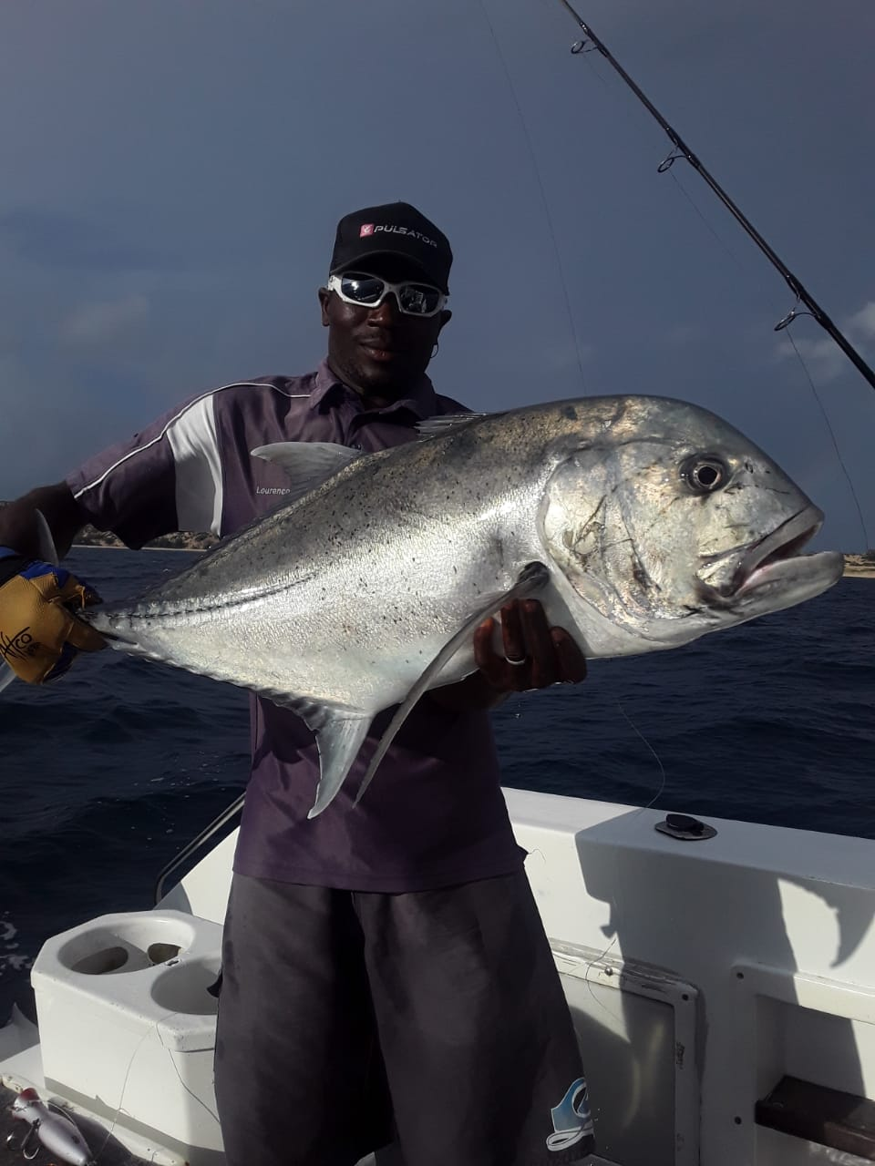 Mozambique GT´s popping and jigging - Straight after, we had another popping charter on Vamizi and the GT bite was really good and even the boys got to pull in a few fish. Here is deckhand Lourenco with yet another GT caught at 9-mile reef